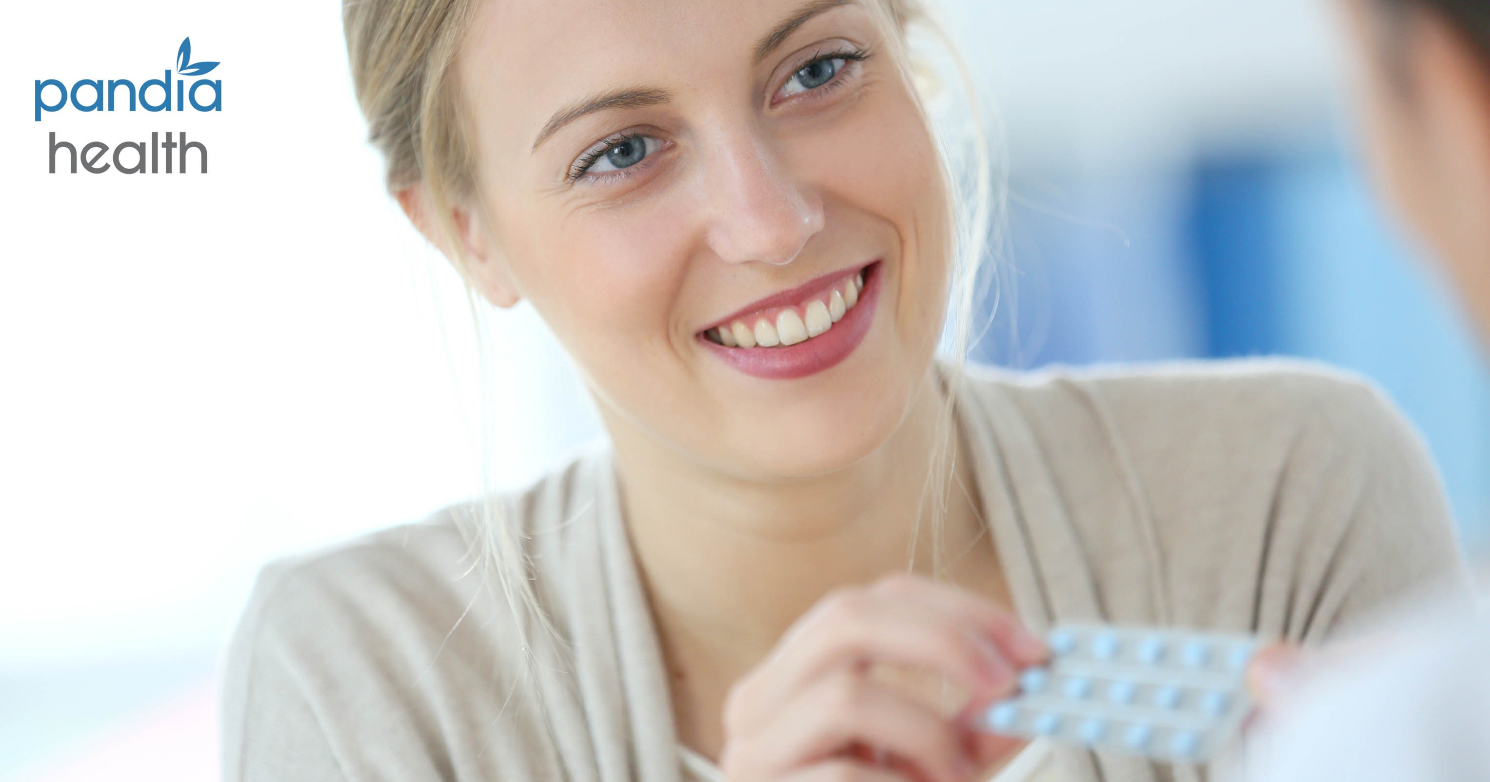 Woman holding birth control pill packet