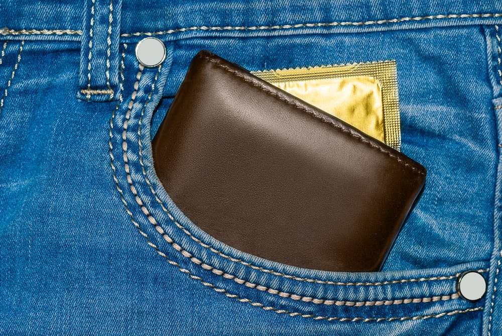 Condom tucked away in jean pocket