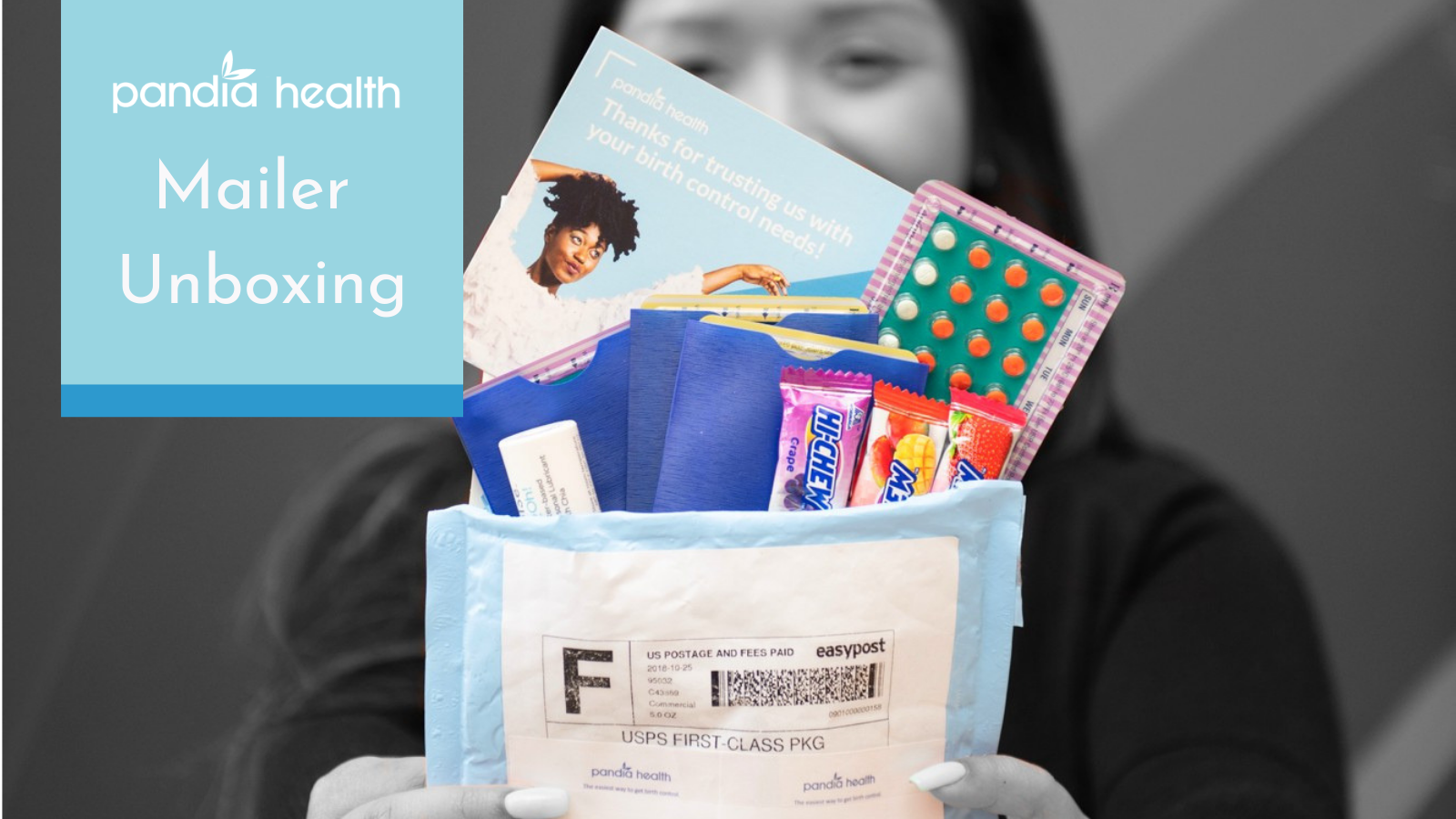 Girl holding Pandia Health mailer, unboxing her birth control and other goodies that come with the package