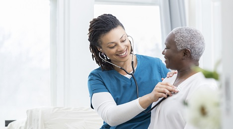 Doctor Taking Care of Elderly Woman
