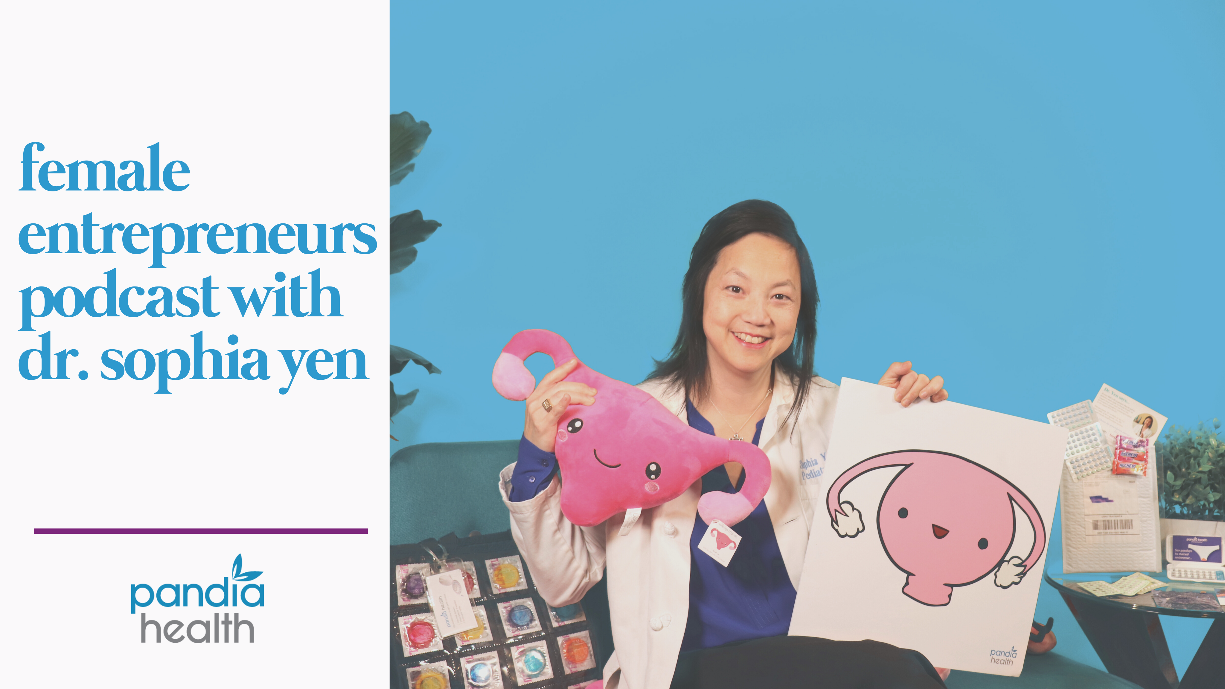 dr. sophia yen holding a pink uterus stuffed animal in one hand and white shirt with uterus on it in the other hand, smiling sitting on couch, condom bag next to her, against a blue background