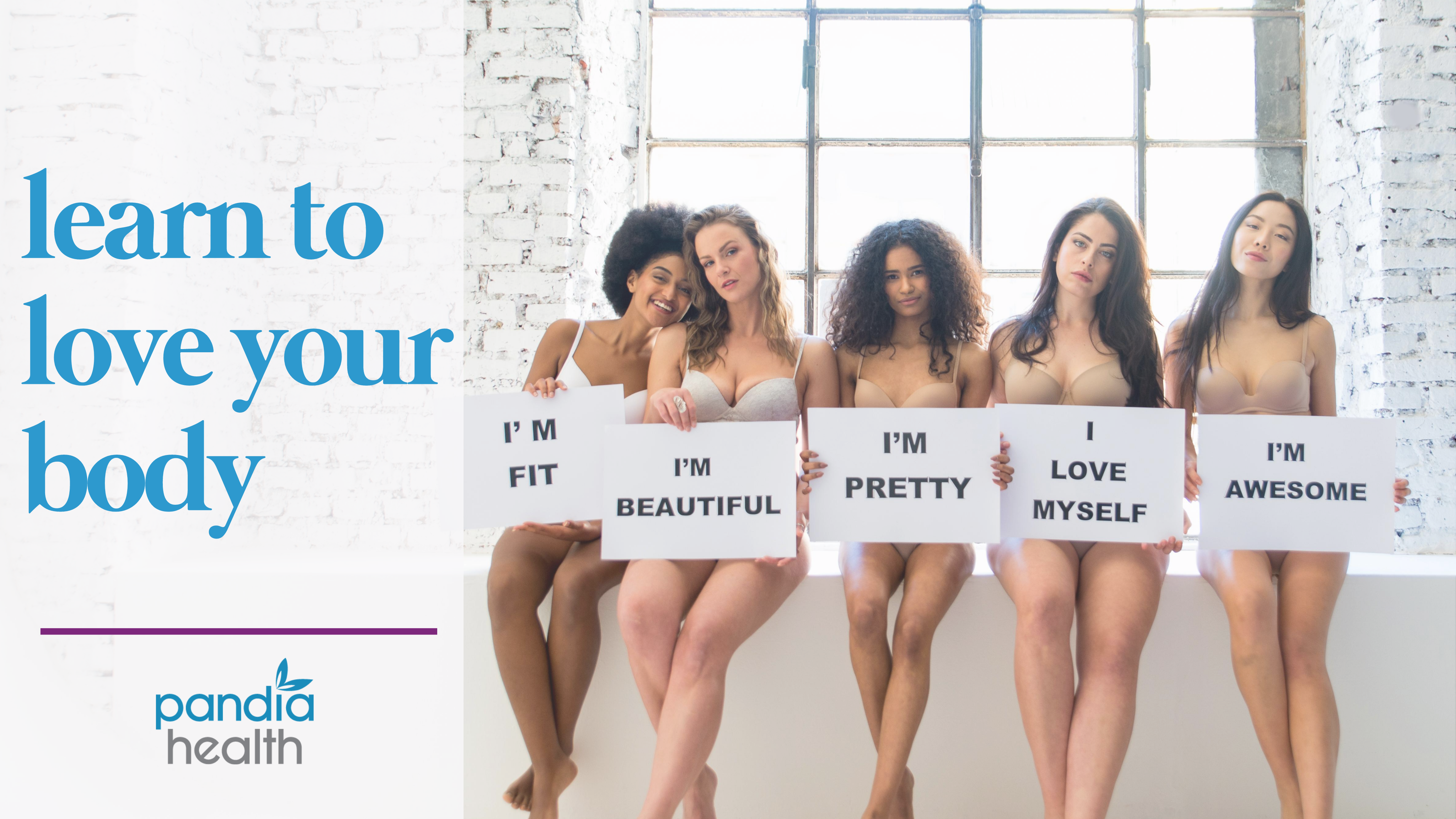 five girls in bras and underwear holding signs promoting body positivity