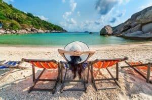 Woman Relaxing On Beach Despite Period