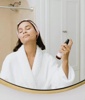 Woman Spraying Facial Moisturizer To Prevent Acne